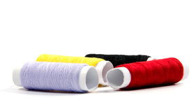 Colorful spools of thread isolated on white Royalty Free Stock Photos