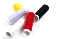 Colorful spools of thread isolated Stock Images