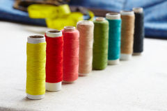 Colorful spools of thread located as a rainbow Royalty Free Stock Photos