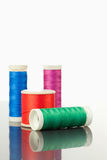 Colorful spools of thread on a table Royalty Free Stock Image
