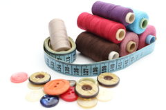 Colorful spools of thread, tape measure and colored buttons Stock Image