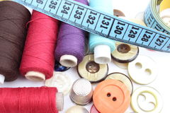 Colorful spools of thread, tape measure, thimble and buttons Stock Image