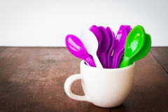 Colorful spoons and glass Stock Photography