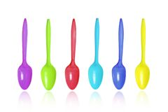 Colorful spoons. Colorful plastic spoons isolated on white stock images
