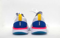 Colorful sport shoes in back view royalty free stock photos