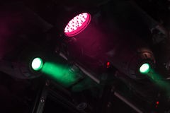 Colorful spot lights above the stage. Colorful spot lights mounted above the stage stock photography