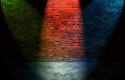 Colorful spot lights on brick wall. Colorful spot lights on old brick wall royalty free stock images