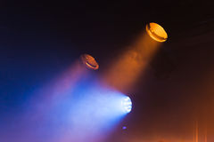Colorful spot lights and scenic smoke. Stage illumination background photo Stock Photo