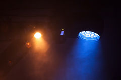 Colorful spot lights in scenic smoke. Stage illumination background photo Stock Photography