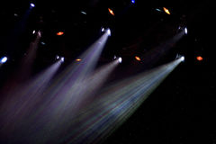 Colorful spotlights in theatre. Colorful arrangement of spotlights shining in theatre royalty free stock photo