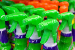 Colorful spray bottles with cleaning agents Royalty Free Stock Images