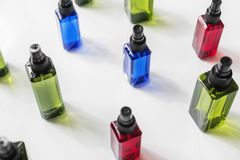 Colorful spray bottles isolated on white background Royalty Free Stock Photography