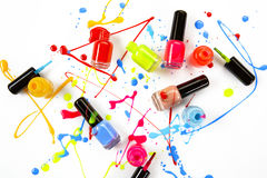 Colorful spray of nail polish from glass bottles as an abstract painting. Royalty Free Stock Images