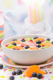 Colorful spring dessert vanilla pudding fruit Stock Photos