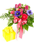 Colorful spring flowers with gift box Stock Image