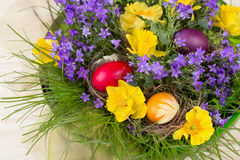 Colorful spring flowers in a green bowl of glass - daffodils, primrose Royalty Free Stock Image