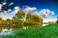 Colorful spring landscape on river Stock Photos