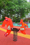 Colorful spring rider in children playground Royalty Free Stock Photos
