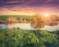 Colorful spring sunrise on fishing pond. Stock Image