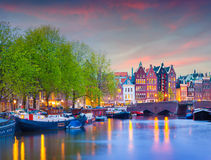 Colorful spring sunset on the canals of Amsterdam. Stock Image