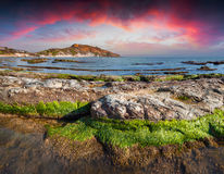 Colorful spring sunset from the Giallonardo beach Royalty Free Stock Image