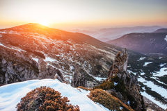 Colorful spring sunset over the mountain ranges in the national Stock Images
