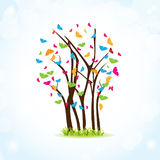 Colorful spring tree with butterflies Royalty Free Stock Photo