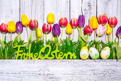 Colorful spring tulips with Easter eggs Royalty Free Stock Image