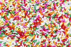 Colorful sprinkles, jimmies for cake or ice cream to Stock Photography