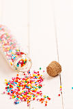 Colorful sprinkles spilled from a jar Royalty Free Stock Photo