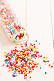 Colorful sprinkles spilled from a jar Stock Photography
