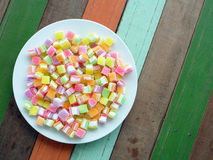 Colorful square jellys. In a dish on the table stock image