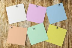 A post it on a wood background.3d rendering. Colorful square post it on a wood background.3d rendering Stock Photo