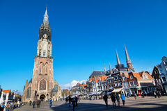 Colorful square view with houses, New Church, people in Delft, Holland Stock Photos