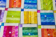 Colorful squares of fabric. Royalty Free Stock Photography