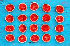 Colorful squeezed ruby grapefruit background Stock Photos