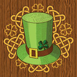 Colorful St. Patricks Day hat and ornament on wood background. Stock Image