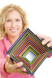 Colorful stack of boxes. Blonde woman holding colorful gift boxes royalty free stock photos