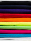 Colorful stack of clean t-shirts Stock Photo