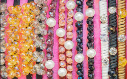 Colorful stack jewelry and pearl headband. Close up colorful stack jewelry and pearl headband or hoop for hair dressing accessories in many fashion stytle, gold Stock Photos