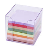 Isolated Office Notes in Holder. A colorful stack of notes still in their nylon wrap inside a transparent plastic note holder. Shallow depth of field Stock Image