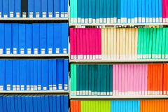 Colorful stack of research books in a university library, with blank book spines. Useful as a background stock photo