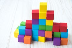 Colorful stack of wood cube building blocks.  stock image
