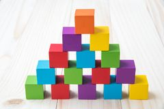 Colorful stack of wood cube building blocks.  royalty free stock image