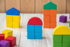 Colorful stack of wood cube building blocks.  stock photo