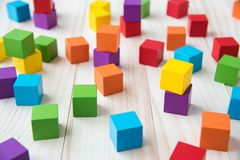 Colorful stack of wood cube building blocks.  stock photos