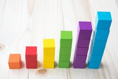 Colorful stack of wood cube building blocks.  royalty free stock images