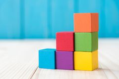 Colorful stack of wood cube building blocks.  stock photography