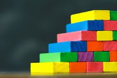Colorful stack of wood cube building blocks. For child stock image
