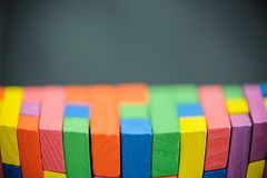 Colorful stack of wood cube building blocks. For education stock photo
